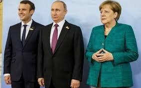 Меркель і Макрон поговорили з Путіним про мінські домовленості на тлі зміни влади в Україні
